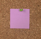 Purple Note on Cork Board Stock Image
