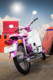 Purple old generation motorcycle Royalty Free Stock Photography