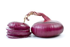 Purple onion and some slices. Isolated on the white background Stock Image