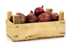 Purple onions in  a wooden box Royalty Free Stock Photos
