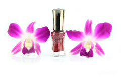 Purple orchid and brown Perfume bottles. Stock Photo