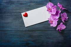 Purple Orchid and envelope Royalty Free Stock Image
