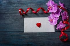 Purple Orchid and envelope Stock Photography