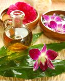 Purple orchid and massage oil Royalty Free Stock Photography