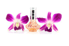 Purple orchid and Orange Perfume bottles. Royalty Free Stock Photo