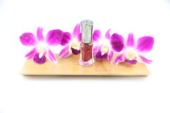 Purple orchid and perfume bottles in bamboo dish Stock Photo