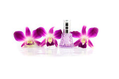 Purple orchid and  Purple Perfume bottles. Royalty Free Stock Images