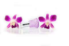 Purple orchid and  Purple Perfume bottles. Royalty Free Stock Photos