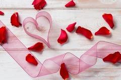 Purple Organza Ribbon Heart, Streamer, and Rose Petals Stock Photography