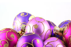 Purple Ornaments. Christmas ornaments with gold glitter detail against white background stock photo