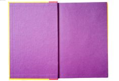 Purple Pages in a Book. A very colorful book that has purple pages stock image