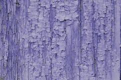 Purple paint crack on wood Stock Photo