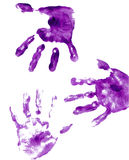Purple painted hand prints Royalty Free Stock Photos