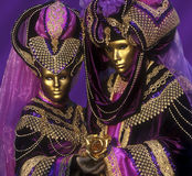 Purple Pair Venice. Portrait of two models dressed in costumes at the Venice carnival Stock Photography