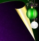 Purple paper and Christmas balls. On a dark background are a purple sheet of paper with golden corner and Christmas balls Royalty Free Stock Photo