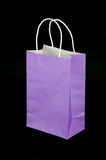 Purple paper gift bag isolated on black background Royalty Free Stock Image
