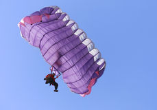 Purple parachute. A purple parachute on a bright sunny day Stock Images