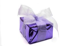 Purple parcel. Tied with a white ribbon Stock Image