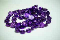 Purple party beads on table royalty free stock image