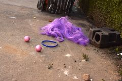 Purple Party Wig on the Sidewalk stock image