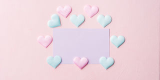 Purple pastel card and hearts on pink banner background Royalty Free Stock Photos