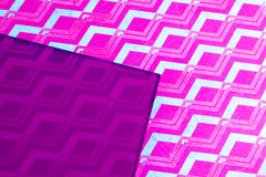 Purple patterned paper with plastic sheet Royalty Free Stock Image