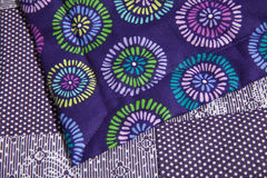 Purple patterned quilt close up Royalty Free Stock Photography
