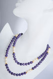 Purple and pearl beaded necklace royalty free stock photo