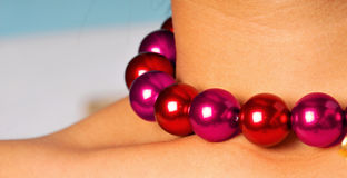 Purple pearls. On models neck Stock Images