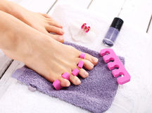 Purple pedicure, groomed female foot Royalty Free Stock Photography