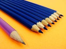 Purple pencil and blue pencils Royalty Free Stock Photos
