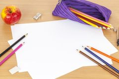 Pencil case and colouring pencils on blank sheets of paper Royalty Free Stock Image