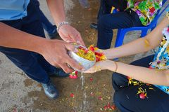 Purple peppersThai festival Songkran. Thai festival Songkran Water blessing ceremony of adults Royalty Free Stock Image
