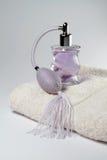 Purple perfume. On the towel Stock Photo