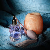 Purple perfume with towel Royalty Free Stock Image