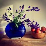 Purple Petaled Flower Arrangement Near Apple Fruit on Table Royalty Free Stock Photos