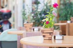 Purple petunia in a small wooden pot Stock Photo