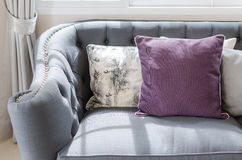 Purple pillow on classic sofa style in living room Stock Photos
