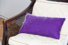 Purple pillow on wooden chair Royalty Free Stock Photography