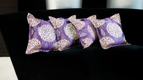 Purple pillows on a sofa Royalty Free Stock Images