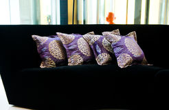 Purple pillows on a sofa Stock Photography