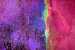 Purple, Pin, Green and Yellow. Textured plaster wall painted multiple bright colors stock photography