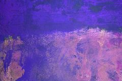 Purple and Pink. Textured plaster wall painted various shades of purple stock photo