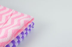 Purple and pink bath-towel stacking on table Royalty Free Stock Photo
