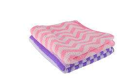 Purple and pink bath-towel stacking on white background Royalty Free Stock Photos