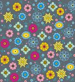 Purple, pink, blue, green and yellow flowers and leaves. A seamless pattern of purple, pink, blue, green and yellow flowers and leaves on a gray background Stock Photo
