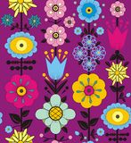 Purple, pink, blue and yellow flowers and leaves. A seamless pattern of purple, pink, blue and yellow flowers and leaves on a purple background Royalty Free Stock Photo