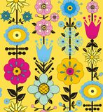 Purple, pink, blue and yellow flowers and leaves. A seamless pattern of purple, pink, blue and yellow flowers and leaves on a yellow background Royalty Free Stock Image