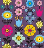 Purple, pink, blue and yellow flowers and leaves. A seamless pattern of purple, pink, blue and yellow flowers and leaves on a gray purple background Royalty Free Stock Photos