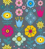 Purple, pink, blue and yellow flowers and leaves. A seamless pattern of purple, pink, blue and yellow flowers and leaves on a gray background Stock Photos
